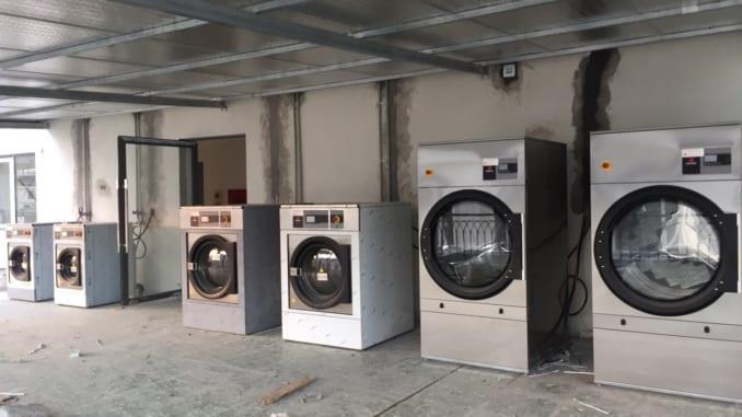 Vì sao nên mua máy giặt công nghiệp mới