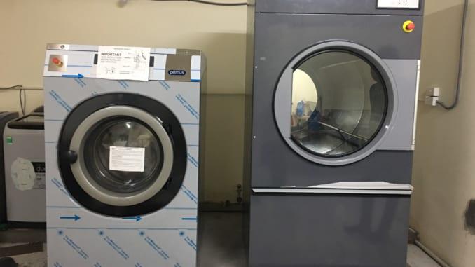 máy giặt là công nghiệp mới